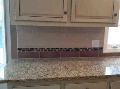 Cabinets, backsplash and countertop