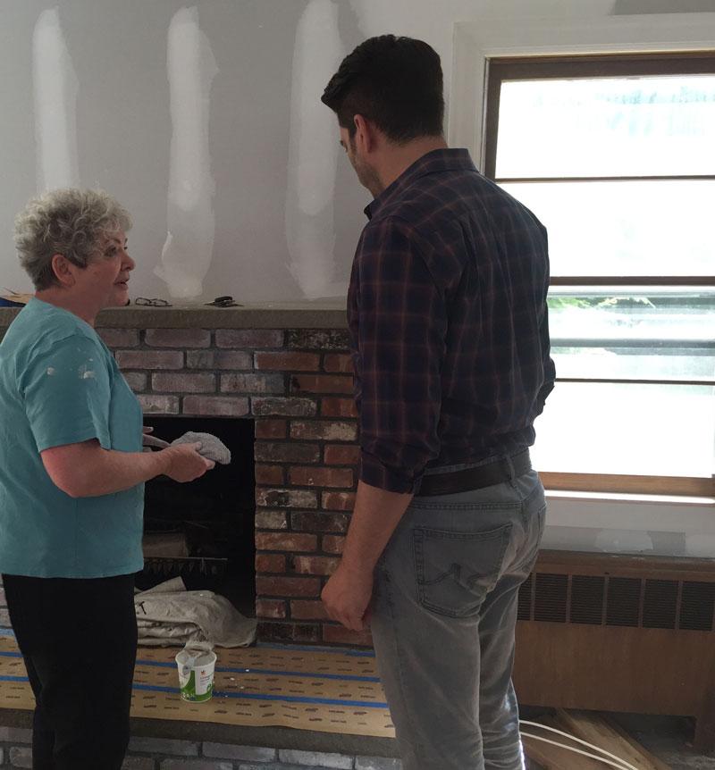 Sharon showing Jonathan fireplace