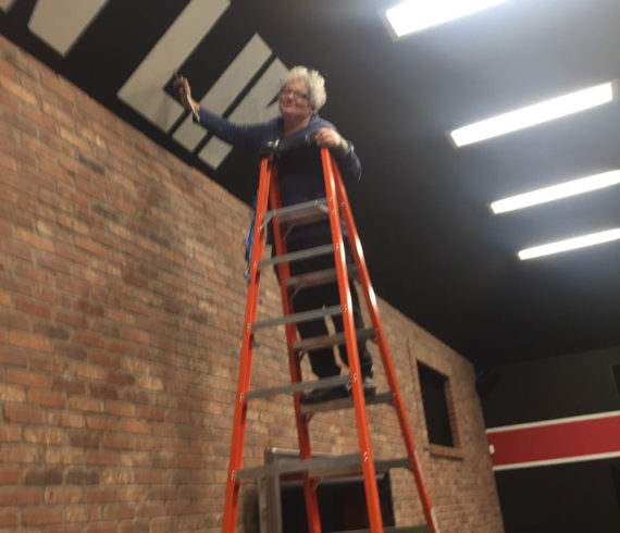 Sharon on Ladder at Gym