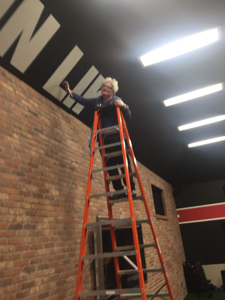 Sharon on Ladder at Gym