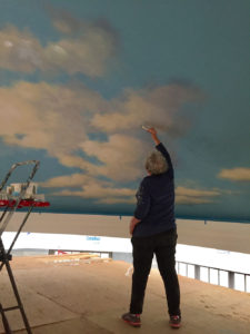 Sharon painting clouds