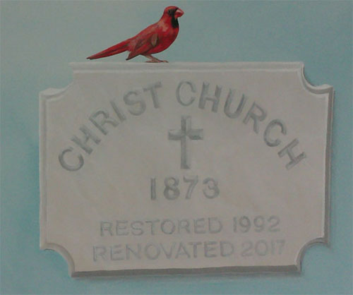 Cardinal on Church sign