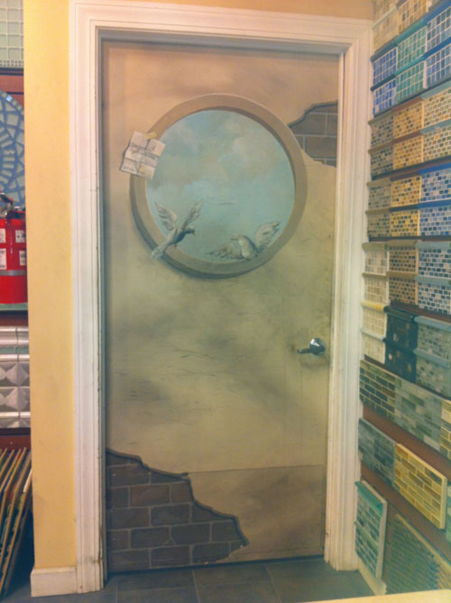 Door with birds through porthole