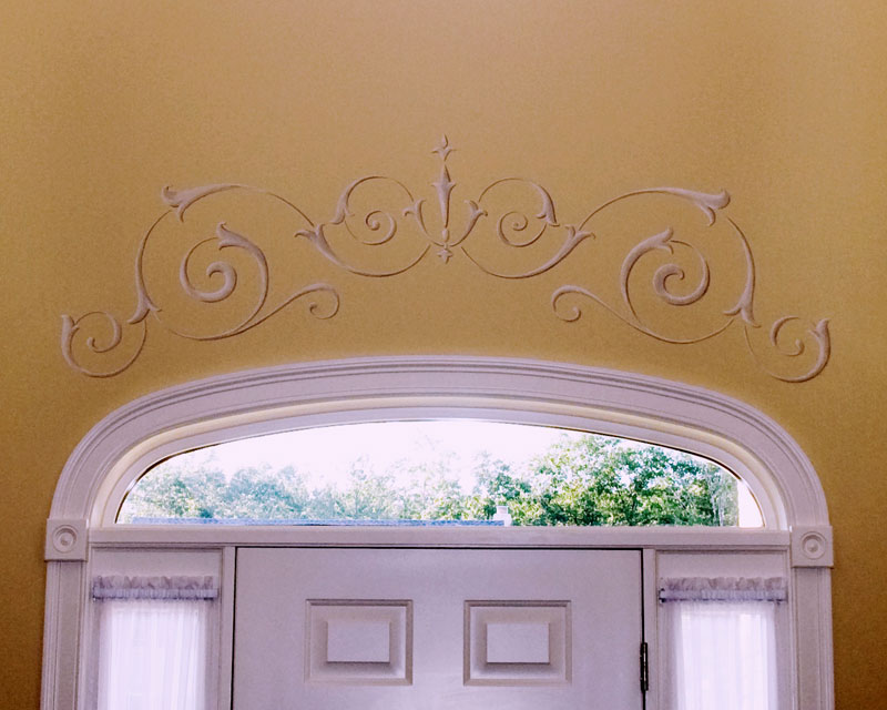 Traditional scrolled ornament over door