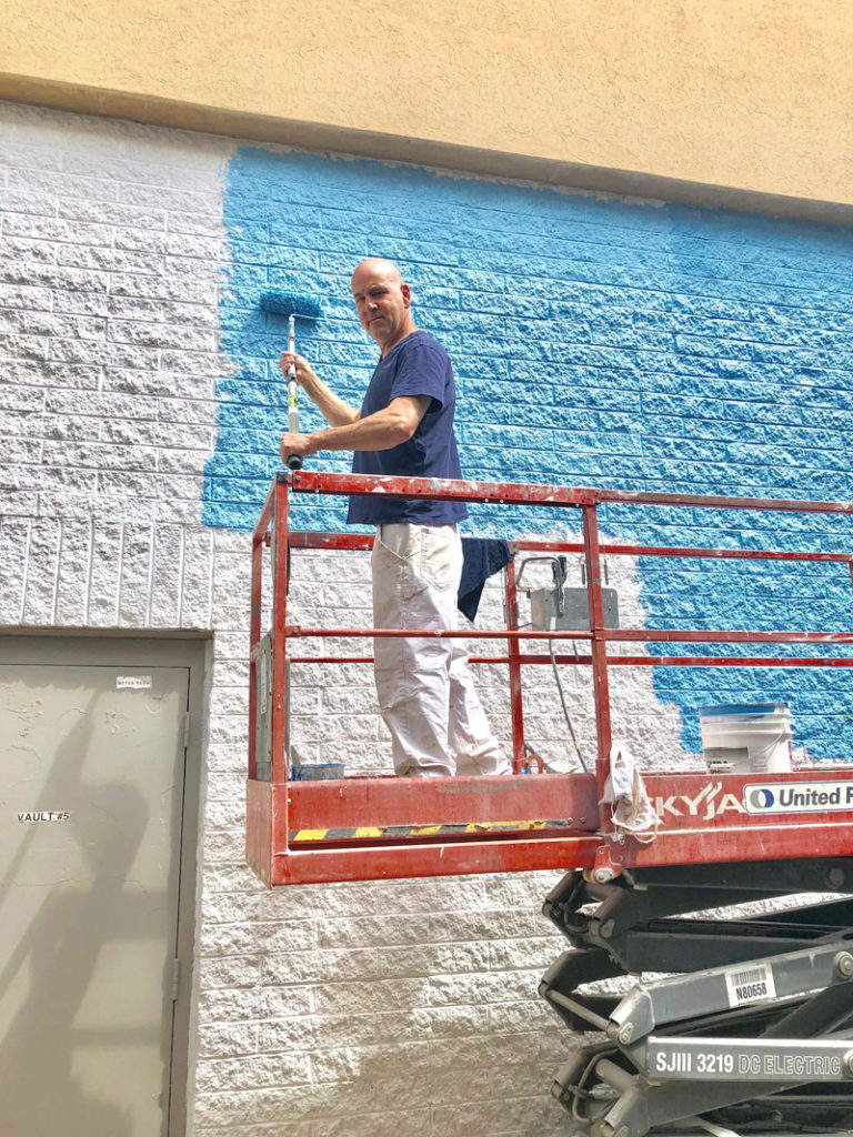 Dino basecoating the wall