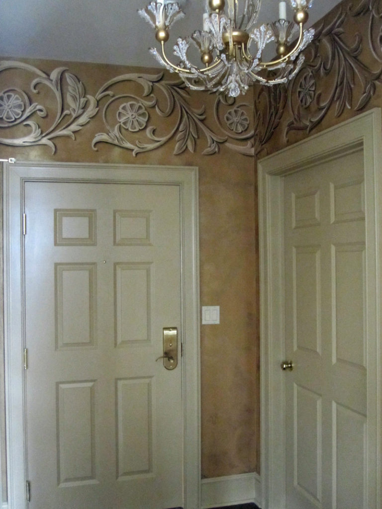 These scrolls were painted in metallic gold with trompe l'oeil shading on walls plastered with LusterStone.