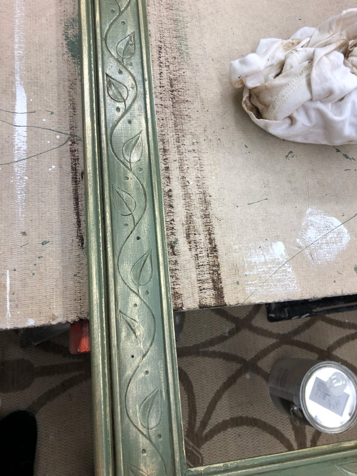 Molding painted green with wax and gold gilding