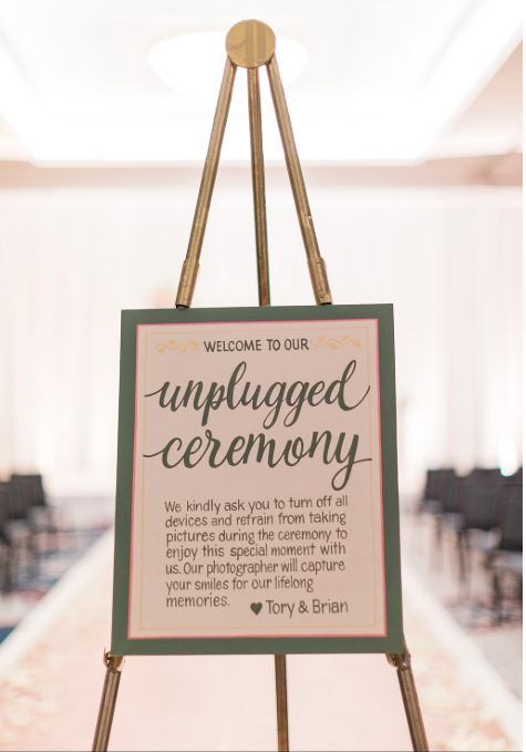 Unplugged sign at ceremony
