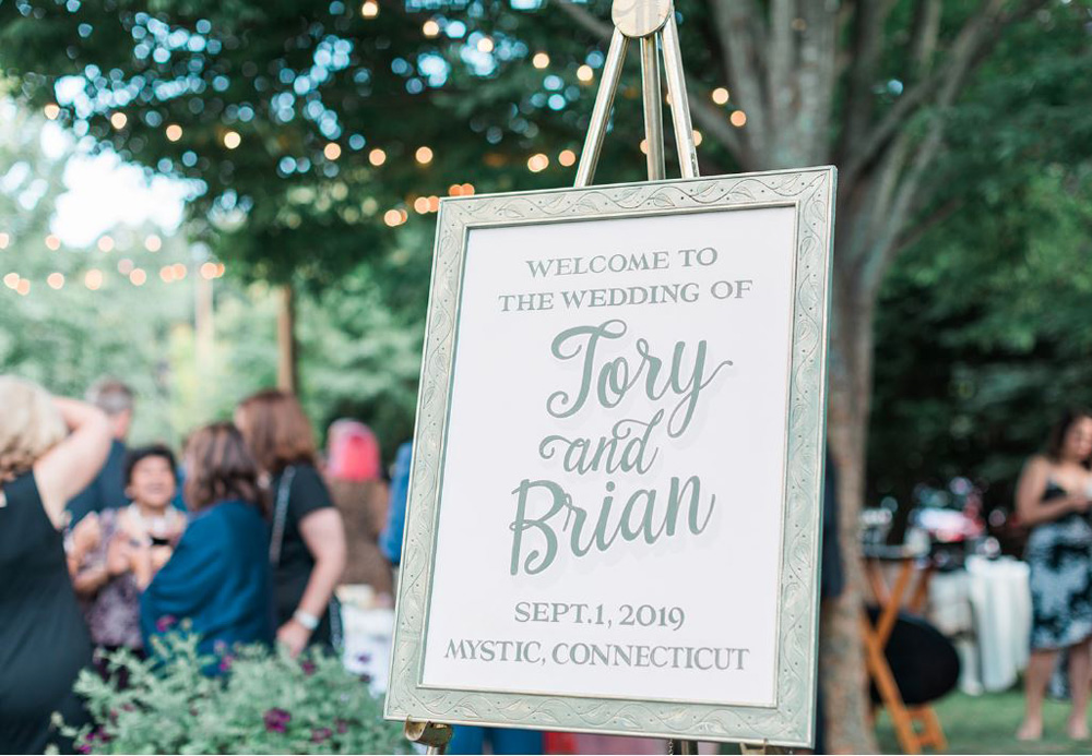 Welcome sign in garden at cocktail hour
