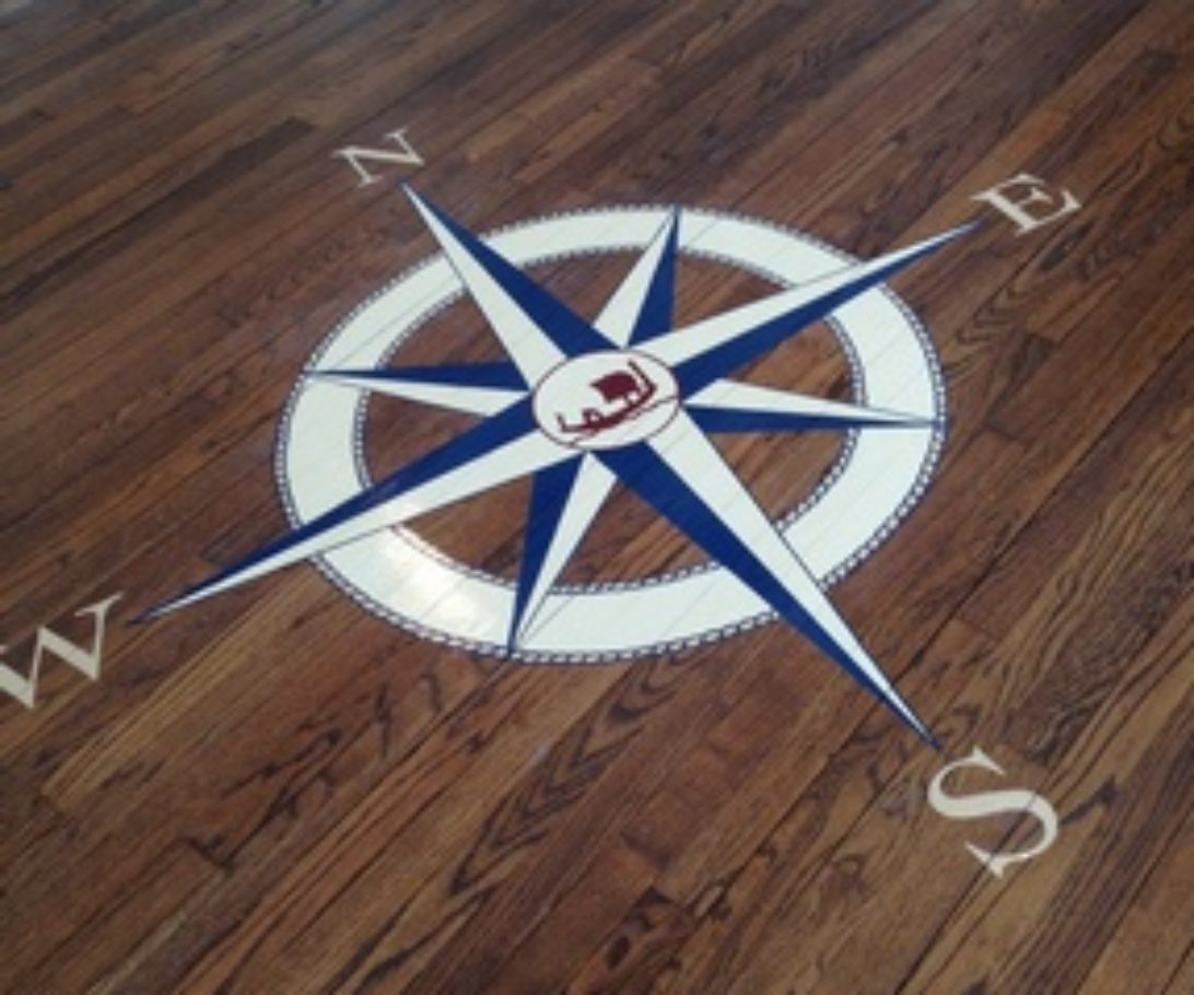 Compass on floor in yacht club