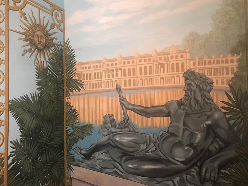Powder room mural of Poseidon