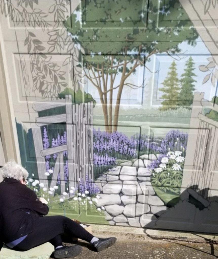 Sharon paints closed garage door