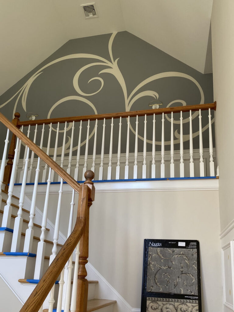 Scrollwork at top of the stairs